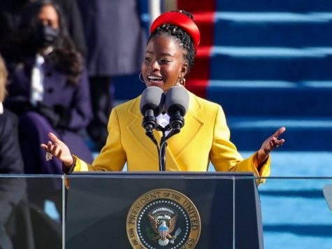 "22 year old Harvard graduate Amanda Gorman reciting her poem ""The Hill We Climb"" at the presidential inauguration. Gorman is the youngest poet to ever recite a piece at an inauguration."