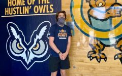 Keegan Shivers at college standing in front of the famous Hooty the owl. Keegan is one of the many young adults to get COVID at college.