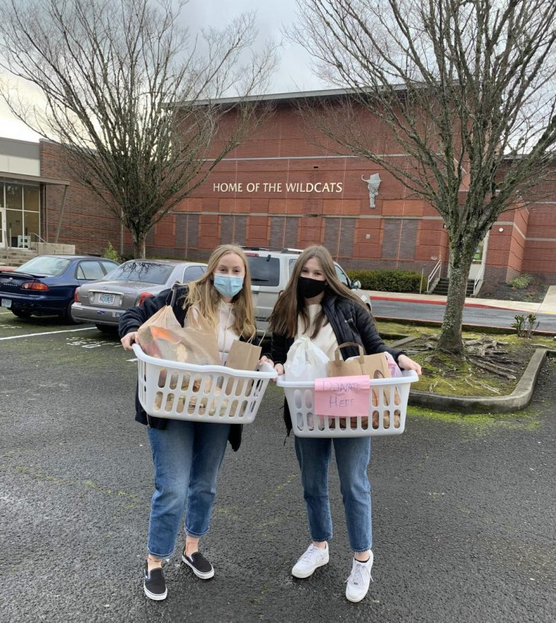 Natalie Opager and Halle Isaak are holding some of the donations dropped off at the High School. The donated goods will be given to Rose Haven.