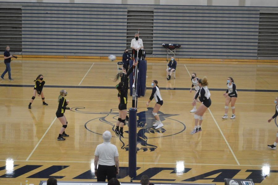 Klein spikes the ball during the second set. The Wildcats won the game in three sets.