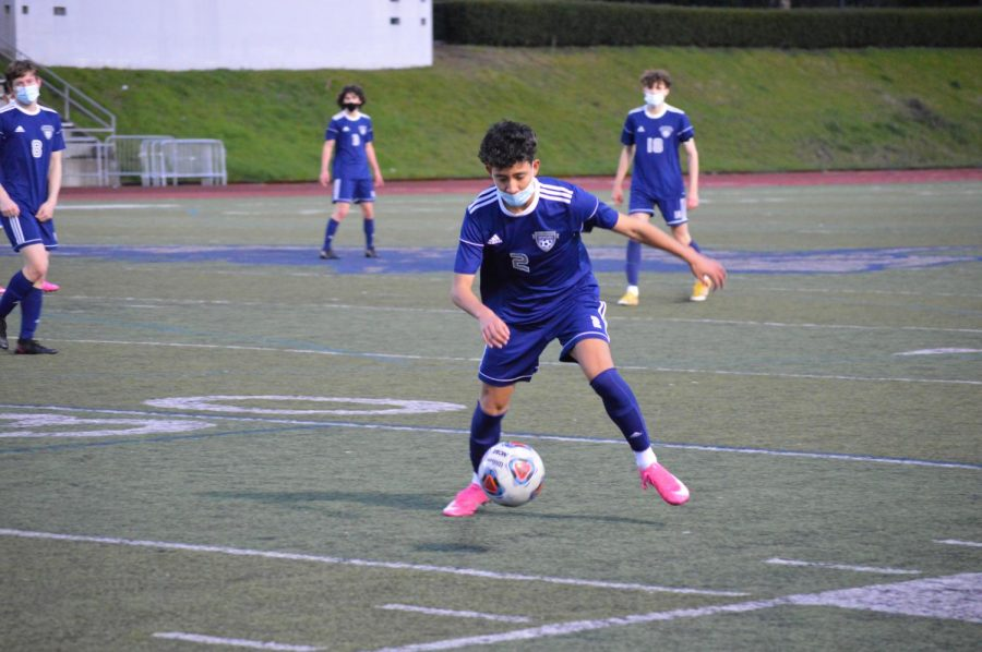 Jesus Loeza controls the ball late in the second half.