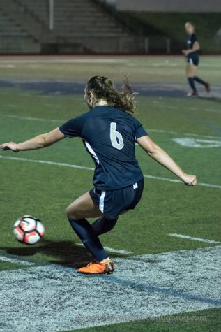 Senior Keira McNamee delivers a ball last season. This year she anchors the Wildcat defense.
