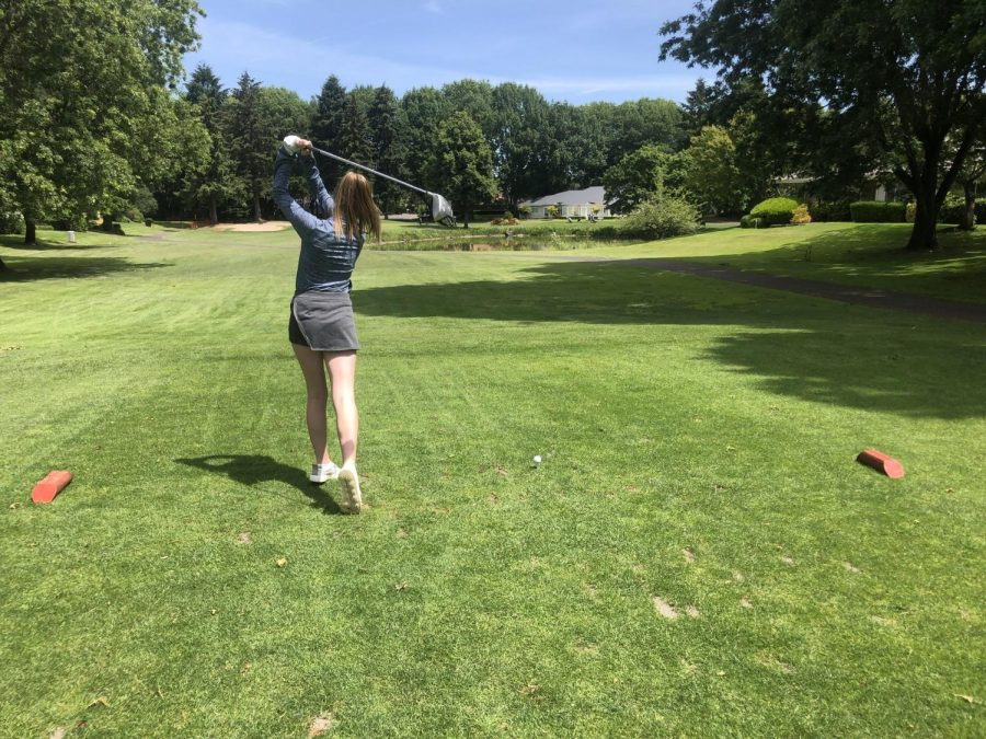 Emma+Dougherty+golfing+on+a+beautiful+day+at+Charbonneau+Golf+Course.
