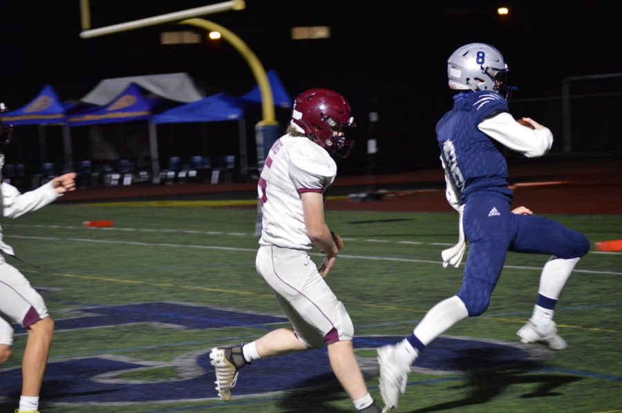 Quarterback Jayce Knapp prances into the endzone for his second todown of the night. The Wildcats win 59-22.