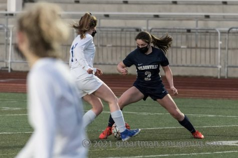 Kenley Whittaker battling for posession of the ball. Kenley Whittaker scored the first two goals of the 4-1 win against Marist.