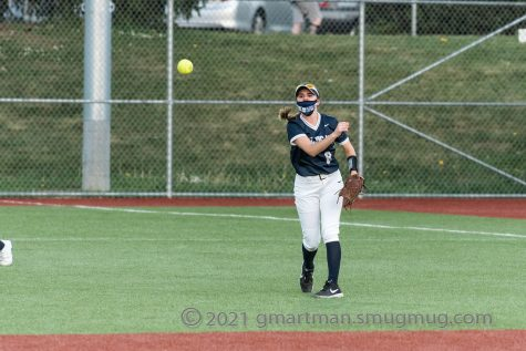 Natalie Adams, junior, releasing the ball to throw back to the infield.