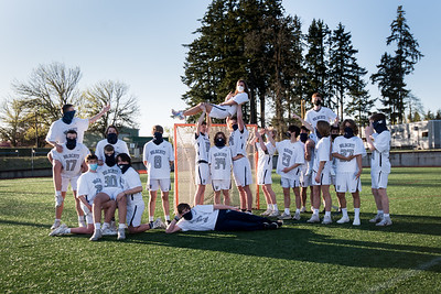 Boys lacrosse posing during a team shoot. They lost on Tuesday 16-6.
