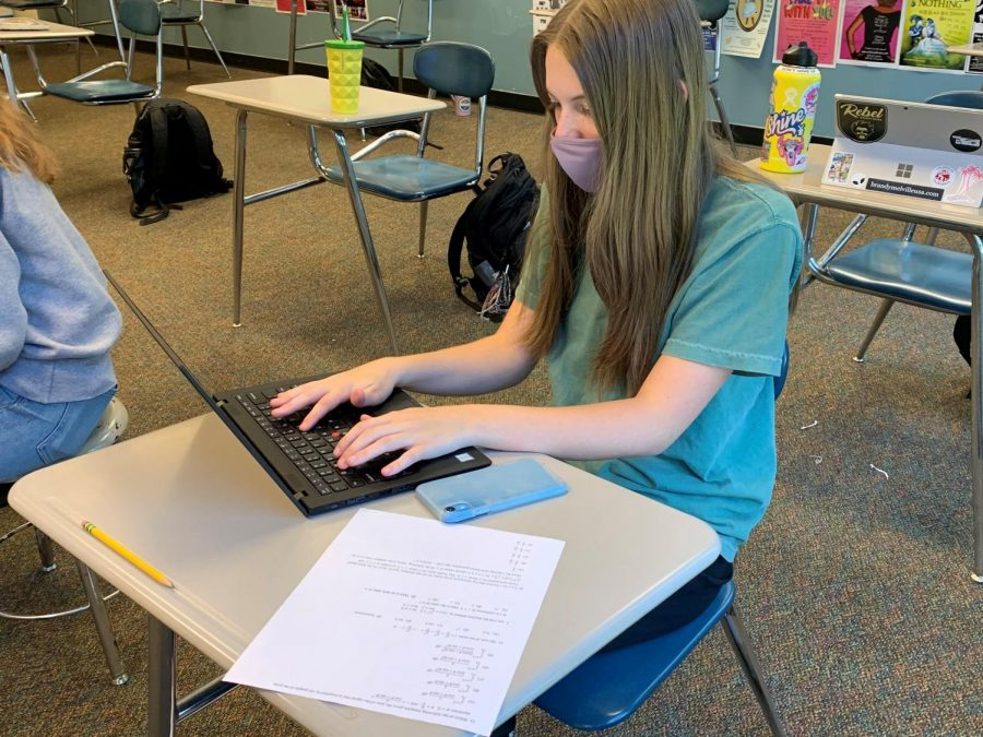 Senior Kate Jeffries studying for her upcoming exams. This year, students have had to adjust their study habits because of the extended timeline of AP tests.