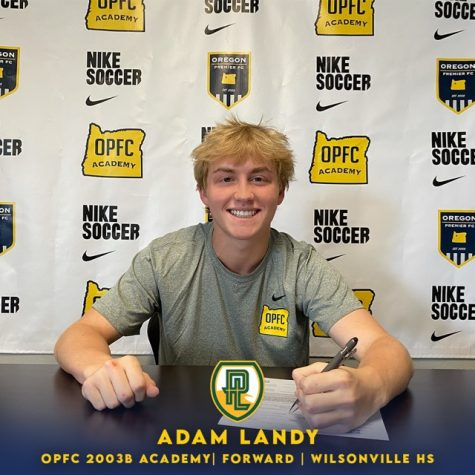 Adam Landy signs official documents stating his commitment to play for Point Loma Nazarene University.