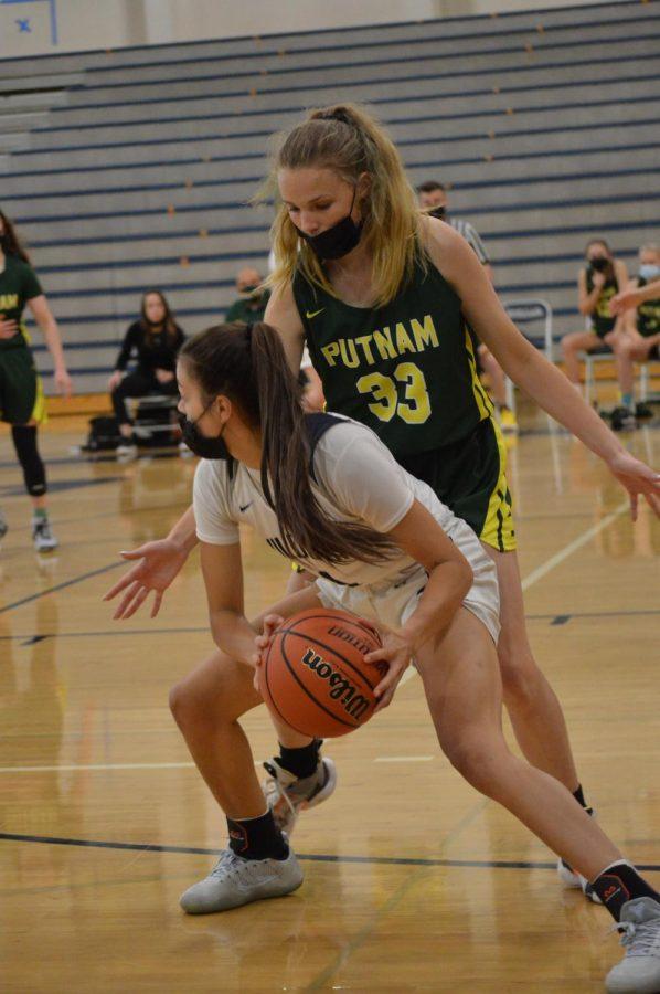 Senior Ellie Grano on offense. Girls basketball takes the W against Putnam 77-56.