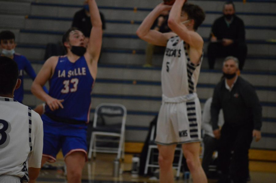 Senior Riley Scanlan shoots the game winning three.