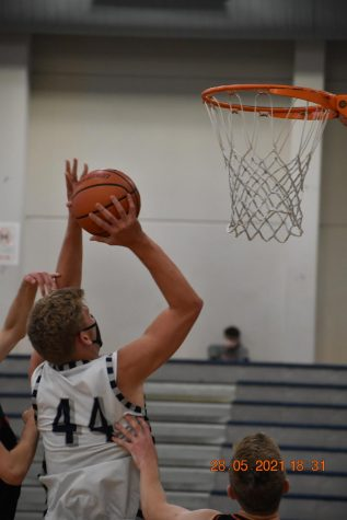 Logan Thieby up close and personal with the rim as he gets the bucket.