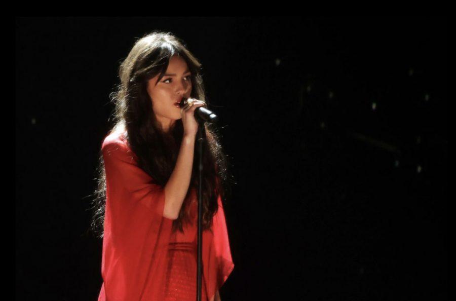 """Olivia Rodrigo performing """"drivers license"""" at the 2021 BRIT Awards."""