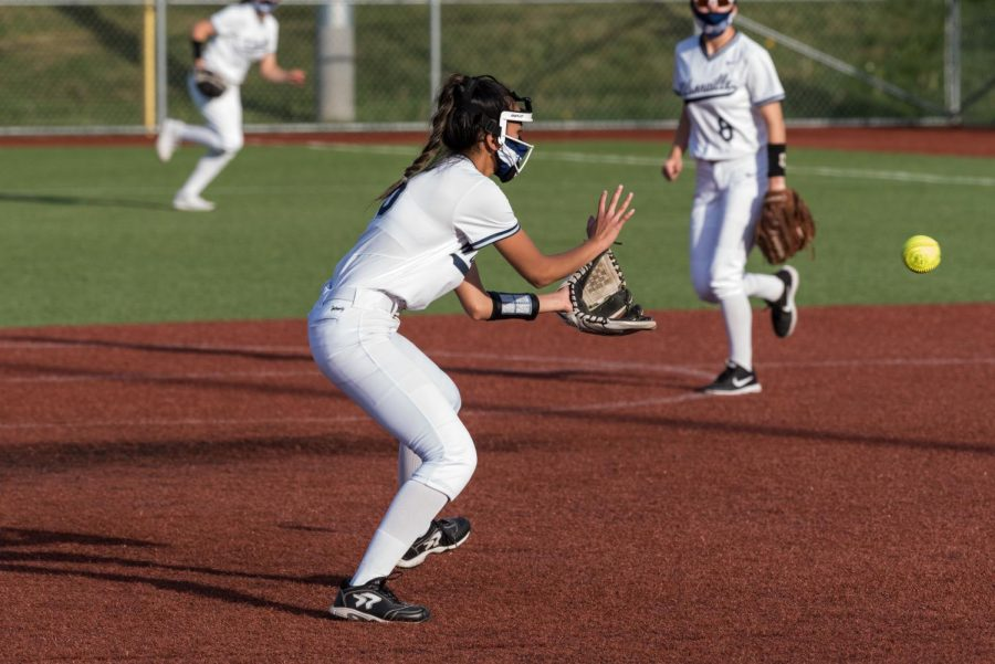 Senior Kylie Hadden fielding a ball during their game against Rex Putnam. The Wildcats finish undefeated in home games and look to play two more games this season.