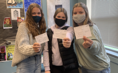 Three WBN students showing off their vaccine cards!
