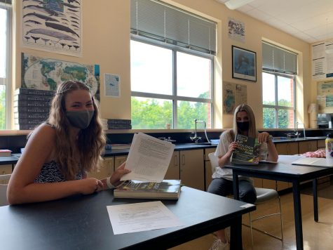 Seniors Maddy DuQuette and Mikayla Brehm work at an AP Biology study group. Both are well versed in many AP classes and share their opinions on their experiences.