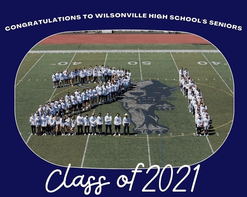Class+of+2021+stand+on+the+main+field+at+Randal+Stadium%2C+creating+a+21.+Photo+belongs+to+WBN