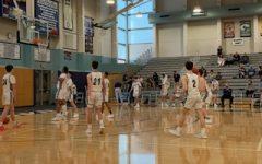 Boys Varsity Basketball team during halftime.