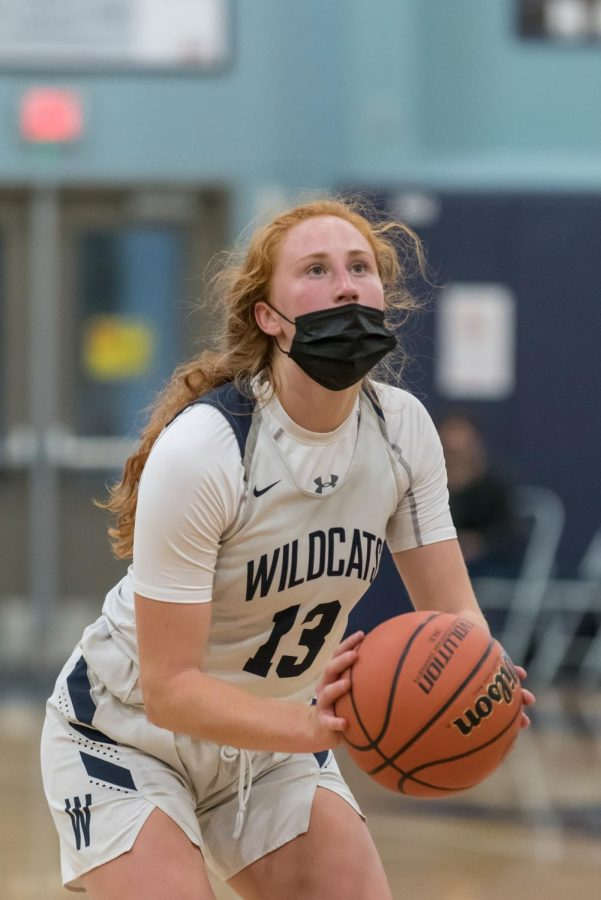 Sydney+Burns+shoots+free+throws+as+she+added+to+the+Wildcat+lead+against+Lincoln.+Wilsonville+went+on+to+win+72-29+as+Burns+led+the+game+in+scoring+with+25.