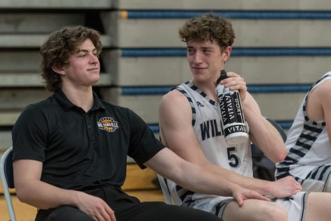 Junior Kellen Hartford and Senior Riley Scanlan share an intimate moment on the  bench.