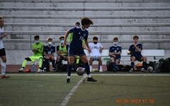Junior Yaseen Mubashir controls the ball in front of his home bench.
