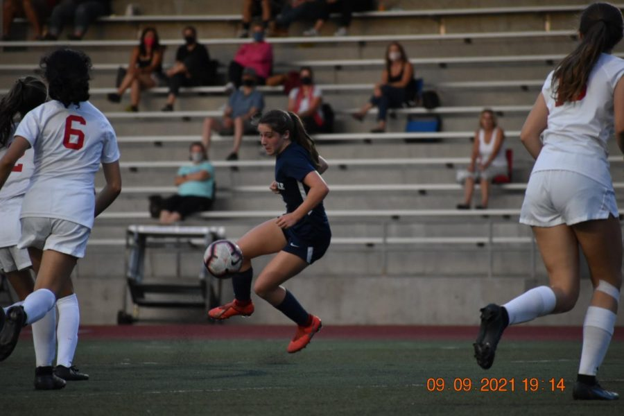 Freshman Kenley Whittaker skillfully juggles the ball as the Cats attempted to extend their lead in the first half.