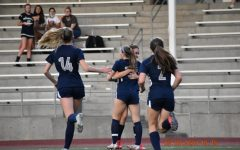 Lindsey Antonson and Karina Borgen embrace after Antonson scored the first goal during their match against Westview.