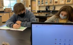 Sophomores Kenley Whittaker and Wyatt  Budeau working hard in class.