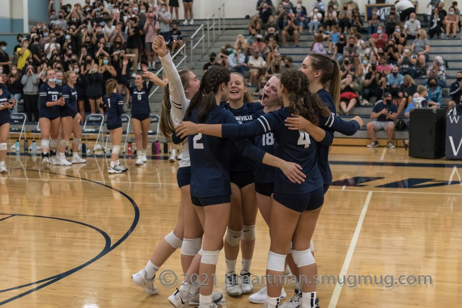 Wilsonville celebrates after taking a second set.