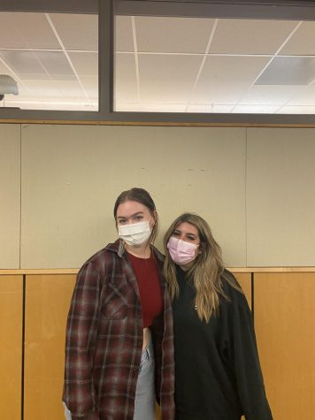 Juniors Elle Bidwell and Katy Bennet pose in front of one of their classrooms.