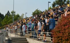 The incoming freshman gather in the bleachers for their introductory gathering before heading into real high school.