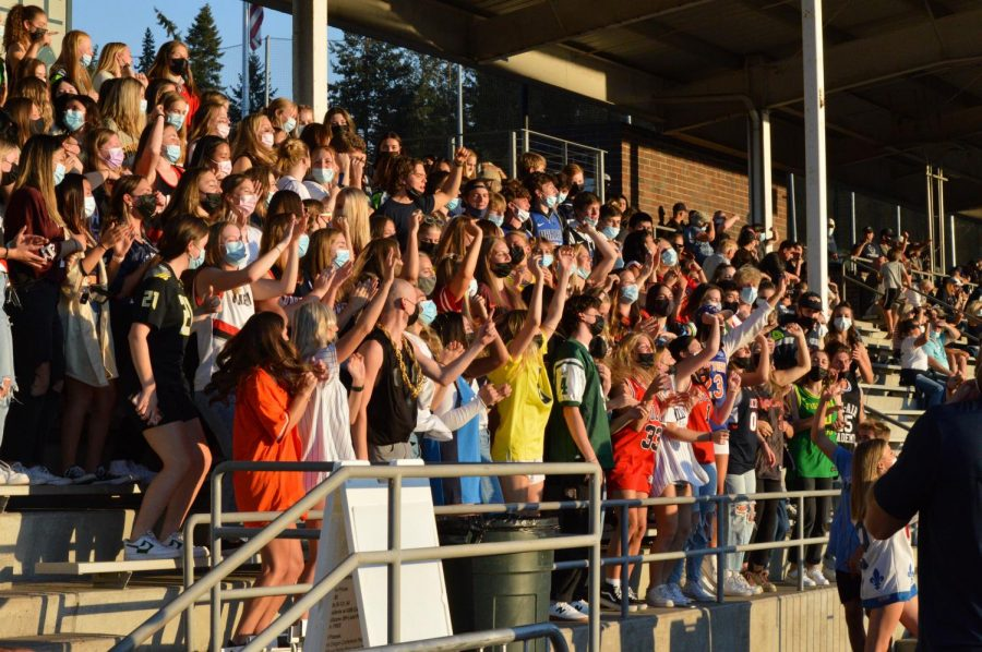 The WVHS student section celebrates during a key play early in the Cats first game.