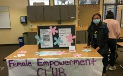 The Female Empowerment Club booth at the club fair! Clubs each had their own booth where they showcased their information and a description of what they do.