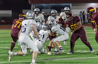 A swarm of Wildcats take down one lone Forest Grove Viking