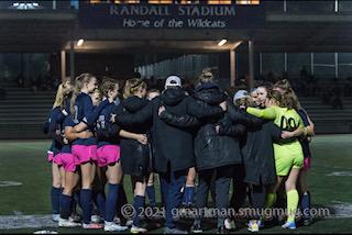Girls Soccer Huddling Before their Game