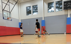 Yok Nuntipak partakes in a two-on-two game with junior Maxim Wu as his teammate. The boys won the half-court game by a small margin, and both were instrumental in the win.