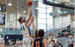 Logan Thebiay goes up for a jump shot in a varsity game this past season.