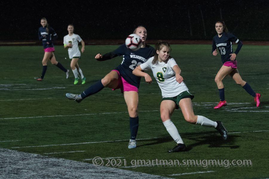 Campbell Lawler battles to keep the ball for Wilsonville.